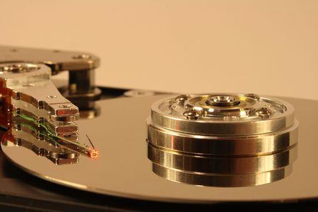 internals: Internals of a hard disk. The head is under a red laser beam.