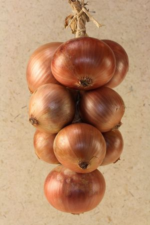 sante: Braid of onions bought on a market. The photo contains a  clipping path. Stock Photo