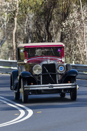 Adelaide, Australia - September 25, 2016: Vintage 1929 Marmon Roosevelt Collapsible Coupe driving on country roads near the town of Birdwood, South Australia.