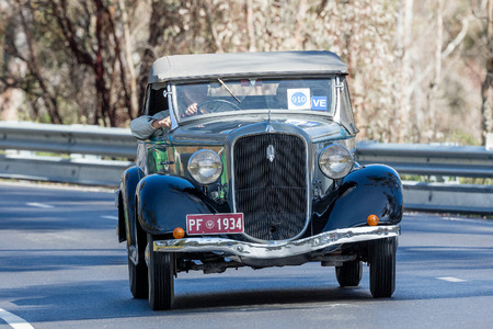 Adelaide, Australia - September 25, 2016: Vintage 1934 Plymouth PF Roadster driving on country roads near the town of Birdwood, South Australia.