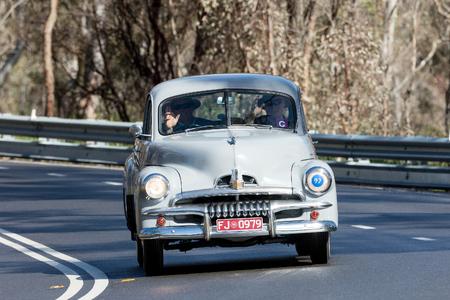 Adelaide, Australia - September 25, 2016: Vintage 1953 FJ Holden Utility (Ute) driving on country roads near the town of Birdwood, South Australia.