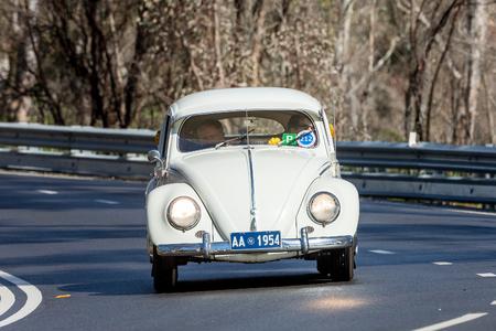 Adelaide, Australia - September 25, 2016: Vintage 1954 Volkswagen Type 1 sedan driving on country roads near the town of Birdwood, South Australia.