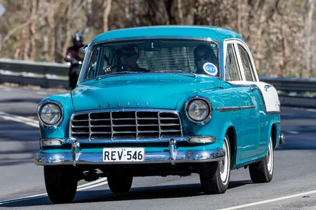 Adelaide, Australia - September 25, 2016: Vintage 1959 Holden FC sedan (FC Holden) driving on country roads near the town of Birdwood, South Australia.