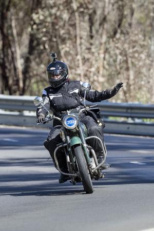 Adelaide, Australia - September 25, 2016: Vintage 1954 BSA Shooting Star Motorcycle on country roads near the town of Birdwood, South Australia.
