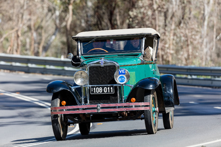 Adelaide, Australia - September 25, 2016: Vintage 1929 Chevrolet AC Roadster driving on country roads near the town of Birdwood, South Australia.