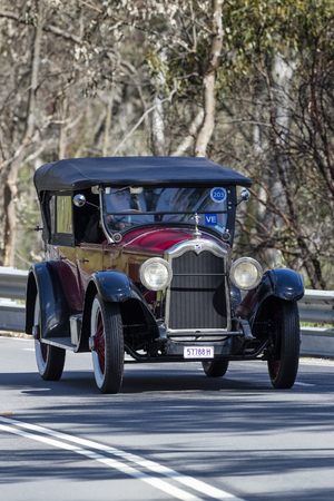 Adelaide, Australia - September 25, 2016: Vintage 1924 Buick 2445X Master B Tourer driving on country roads near the town of Birdwood, South Australia.