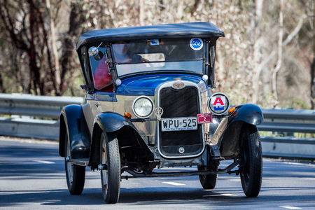 Adelaide, Australia - September 25, 2016: Vintage 1928 Chevrolet National Sports Roadster driving on country roads near the town of Birdwood, South Australia.