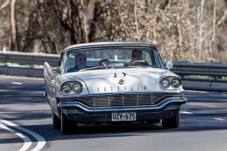 Adelaide, Australia - September 25, 2016: Vintage Chrysler driving on country roads near the town of Birdwood, South Australia.
