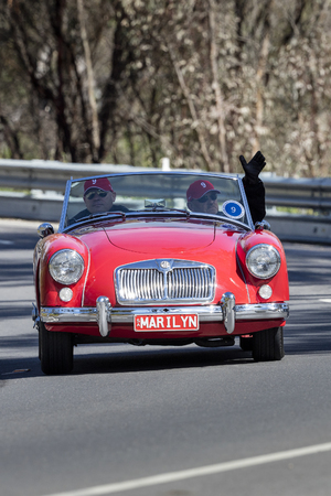 Adelaide, Australia - September 25, 2016: Vintage 1957 MG A Roadster driving on country roads near the town of Birdwood, South Australia.