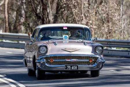 Adelaide, Australia - September 25, 2016: Vintage 1957 Chevrolet Belair Sports Sedan driving on country roads near the town of Birdwood, South Australia. Editorial