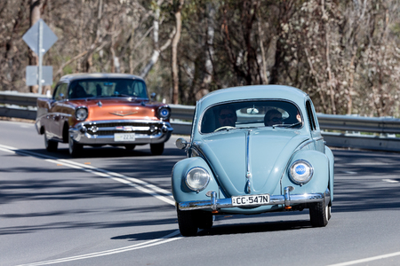 Adelaide, Australia - September 25, 2016: Vintage Volkswagen Beetle driving on country roads near the town of Birdwood, South Australia.