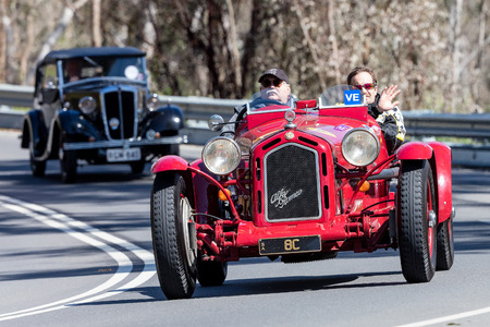 monza: Adelaide, Australia - September 25, 2016: Vintage red 1929 Alfa Romeo Monza Tourer driving on country roads near the town of Birdwood, South Australia.
