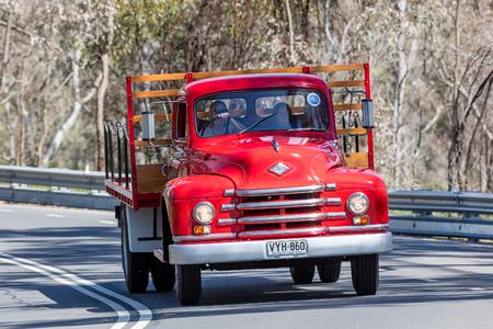 Adelaide, Australia - September 25, 2016: Vintage 1952 Diamond T 520 TrayTop Truck driving on country roads near the town of Birdwood, South Australia.