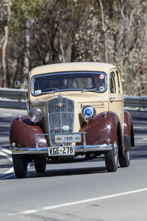 Adelaide, Australia - September 25, 2016: Vintage 1939 Morris M10 Saloon driving on country roads near the town of Birdwood, South Australia. Editorial