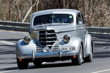 Adelaide, Australia - September 25, 2016: Vintage Oldsmobile driving on country roads near the town of Birdwood, South Australia. Editorial
