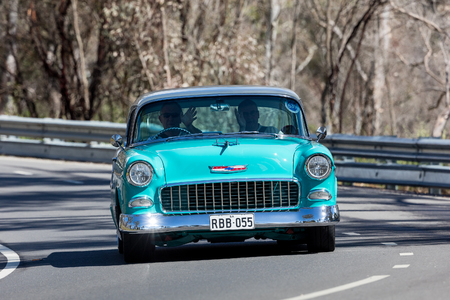 Adelaide, Australia - September 25, 2016: Vintage 1955 Chevrolet Belair Sports Coupe driving on country roads near the town of Birdwood, South Australia.