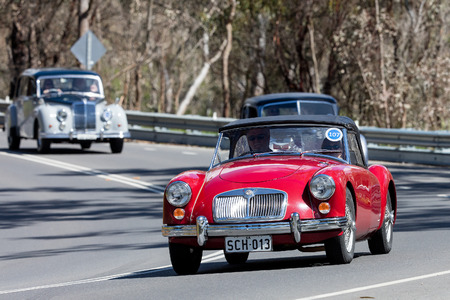 Adelaide, Australia - September 25, 2016: Vintage 1959 MG A Tourer driving on country roads near the town of Birdwood, South Australia.