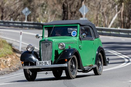 Adelaide, Australia - September 25, 2016: Vintage 1937 Austin 7 Roadster driving on country roads near the town of Birdwood, South Australia.