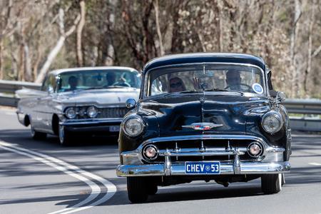 Adelaide, Australia - September 25, 2016: Vintage 1953 Chevrolet Belair Sedan driving on country roads near the town of Birdwood, South Australia. Editorial