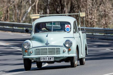 Adelaide, Australia - September 25, 2016: Vintage 1953 Morris Minor Utility (Ute) driving on country roads near the town of Birdwood, South Australia. 版權商用圖片 - 85227554