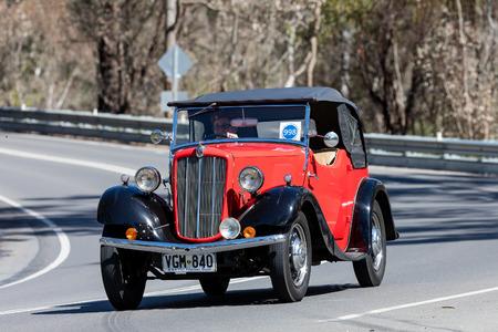 Adelaide, Australia - September 25, 2016: Vintage Morris driving on country roads near the town of Birdwood, South Australia. Editorial