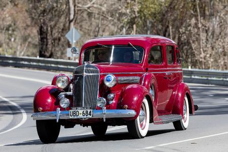 Adelaide, Australia - September 25, 2016: Vintage 1936 Chrysler C8 Sedan driving on country roads near the town of Birdwood, South Australia.