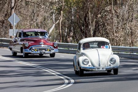 Adelaide, Australia - September 25, 2016: Vintage 1959 Volkswagen Type 1 Sedan driving on country roads near the town of Birdwood, South Australia.
