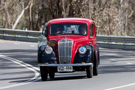 Adelaide, Australia - September 25, 2016: Vintage 1948 Morris Series E Sedan driving on country roads near the town of Birdwood, South Australia.