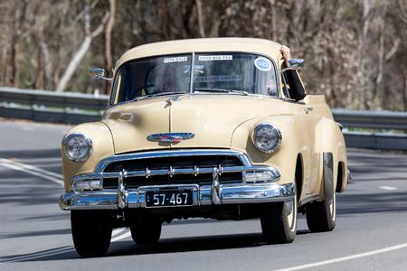 Adelaide, Australia - September 25, 2016: Vintage 1957 Chevrolet Utility driving on country roads near the town of Birdwood, South Australia.