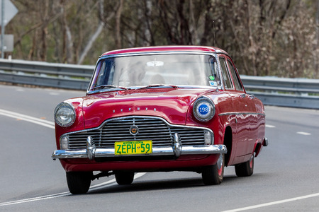 Adelaide, Australia - September 25, 2016: Vintage 1959 Ford Zephyr Sedan driving on country roads near the town of Birdwood, South Australia.