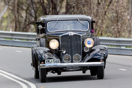 Adelaide, Australia - September 25, 2016: Vintage 1933 Hupmobile K Sedan driving on country roads near the town of Birdwood, South Australia. Editorial