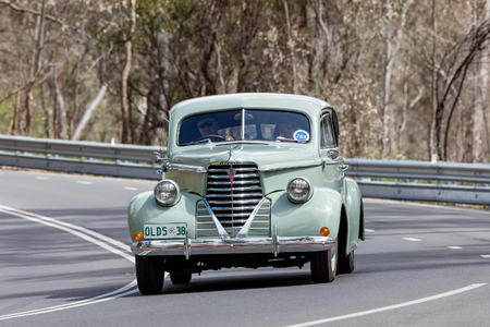Adelaide, Australia - September 25, 2016: Vintage 1938 Oldsmobile F38 Coupe driving on country roads near the town of Birdwood, South Australia. Editorial