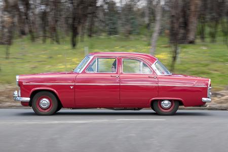 Adelaide, Australia - September 25, 2016: Vintage 1959 Ford Zephyr Sedan driving on country roads near the town of Birdwood, South Australia.