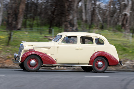Adelaide, Australia - September 25, 2016: Vintage 1937 Chevrolet Master Sedan driving on country roads near the town of Birdwood, South Australia.