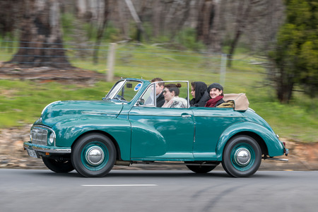 Adelaide, Australia - September 25, 2016: Vintage 1950 Morris Minor Tourer driving on country roads near the town of Birdwood, South Australia. Editorial
