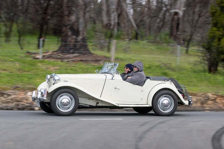 Adelaide, Australia - September 25, 2016: Vintage 1950 MG TD Tourer driving on country roads near the town of Birdwood, South Australia.