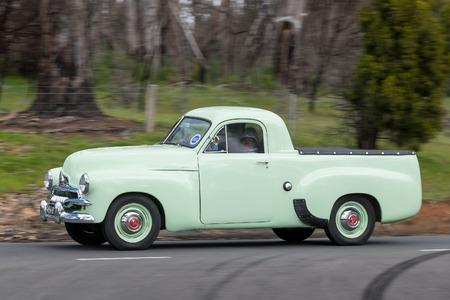 Adelaide, Australia - September 25, 2016: Vintage 1956 Holden FJ Utility driving on country roads near the town of Birdwood, South Australia.