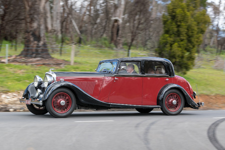 Adelaide, Australia - September 25, 2016: Vintage 1935 Bentley Derby 3.5L Saloon driving on country roads near the town of Birdwood, South Australia. Editorial