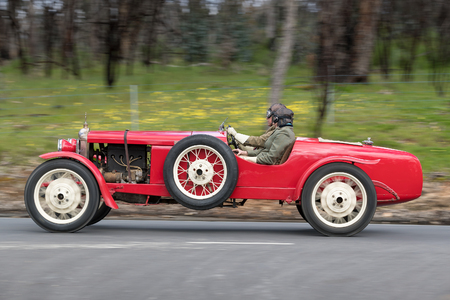 Adelaide, Australia - September 25, 2016: Vintage 1927 Standard 1428 Boattail driving on country roads near the town of Birdwood, South Australia.