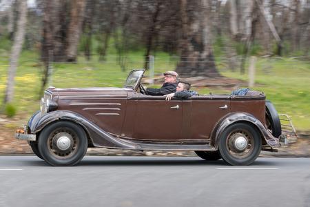 Adelaide, Australia - September 25, 2016: Vintage 1935 Chevrolet Tourer driving on country roads near the town of Birdwood, South Australia.