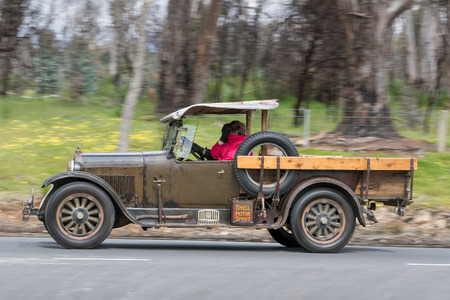 Adelaide, Australia - September 25, 2016: Vintage pickup truck driving on country roads near the town of Birdwood, South Australia. Editorial
