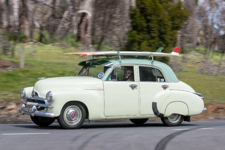 Adelaide, Australia - September 25, 2016: Vintage 1955 Holden FJ Sedan driving on country roads near the town of Birdwood, South Australia. Editorial