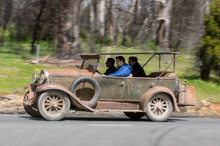 Adelaide, Australia - September 25, 2016: Vintage 1927 Whippet 96 Tourer driving on country roads near the town of Birdwood, South Australia.