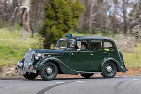 Adelaide, Australia - September 25, 2016: Vintage 1948 Wolseley 1885 Series III Sedan driving on country roads near the town of Birdwood, South Australia.