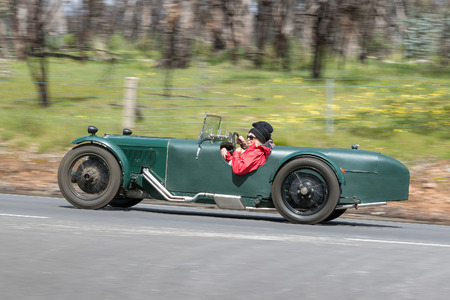 Adelaide, Australia - September 25, 2016: Vintage 1929 Riley Brooklands 9 roadster driving on country roads near the town of Birdwood, South Australia.