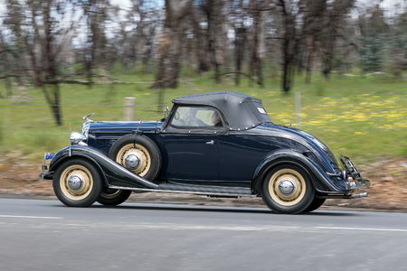 Adelaide, Australia - September 25, 2016: Vintage 1934 Chevrolet DA Master Roadster driving on country roads near the town of Birdwood, South Australia.