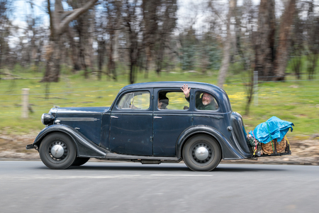 Adelaide, Australia - September 25, 2016: Vintage 1937 Vauxhall DX Saloon driving on country roads near the town of Birdwood, South Australia. Editorial