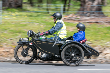 Adelaide, Australia - September 25, 2016: Vintage Motorcycle with sidecar on country roads near the town of Birdwood, South Australia.