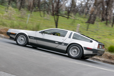 Adelaide, Australia - September 25, 2016: Vintage DMC Delorean driving on country roads near the town of Birdwood, South Australia.