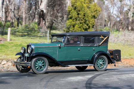 Adelaide, Australia - September 25, 2016: Vintage 1929 Marquette 35 Tourer driving on country roads near the town of Birdwood, South Australia.